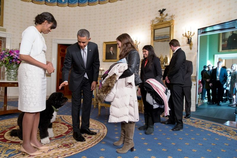 Barack Obama Introducing His Dog To A Guest